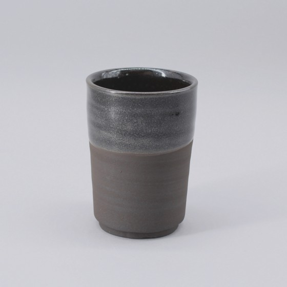 Black stoneware coffee cup.